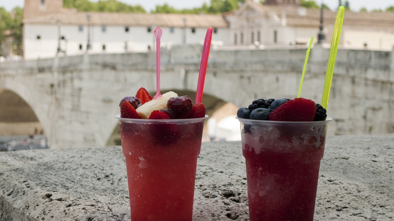 Two typical Granita red fruit drinks near the river Tiber, city of Rome, Italy