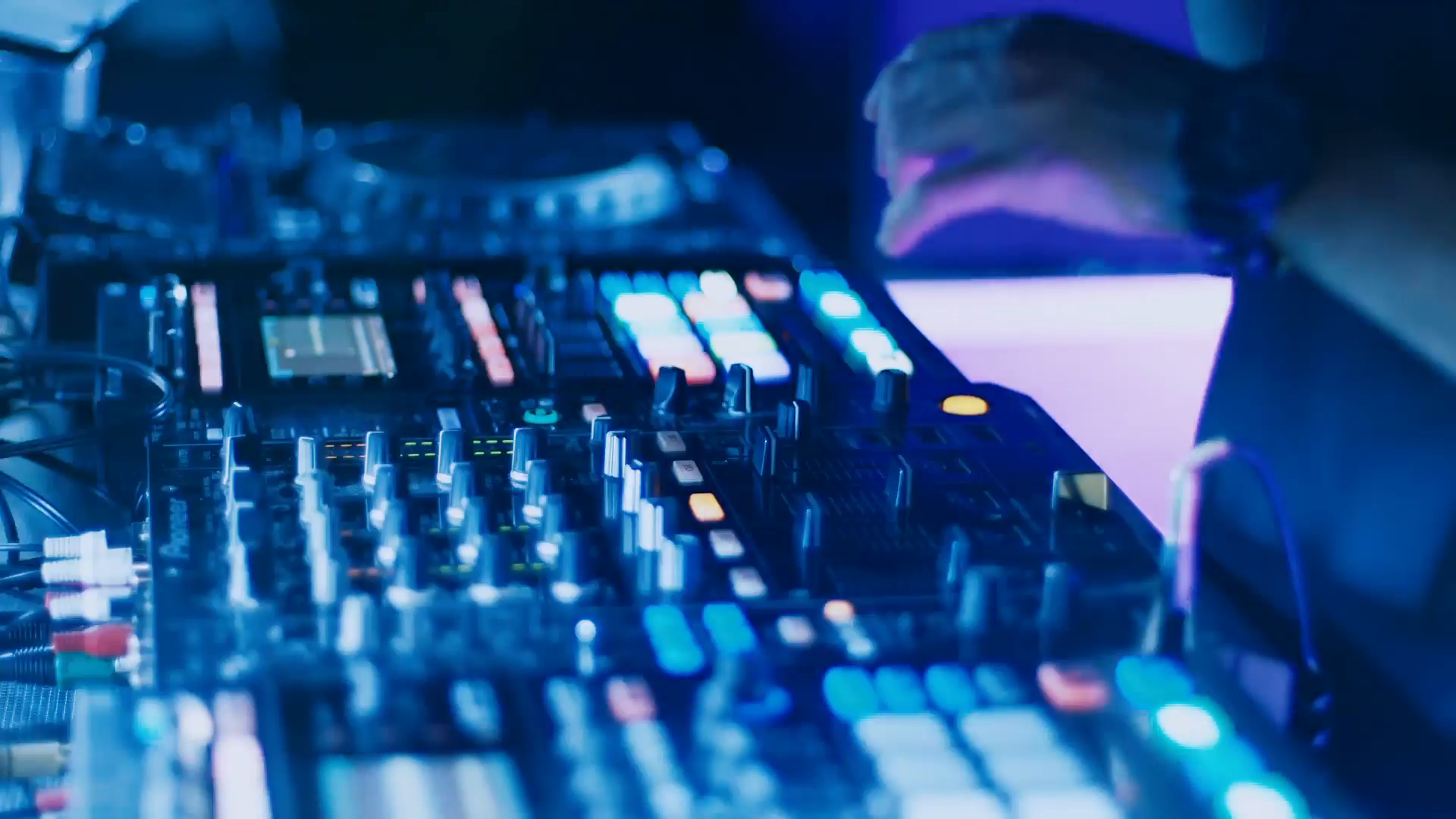 dj-mixing-tracks-on-console-at-dance-music-partya-dj-behind-the-console-on-stage-mixing-tracks-in-atmospheric-dance-party-strobing-and-flashing-lights-more-from-this-collection-below_ejrg-fu5__F0003